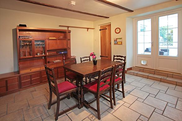 Interior of Rose Cottage: Dining                   area, utility room and conservatory