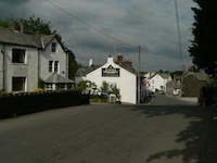 Threlkeld village main                   street, with Rose Cottage and the Horse & Farrier                   pub